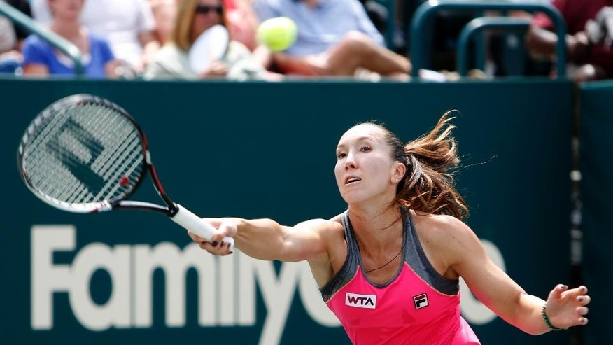 Jelena Jankovic, of Serbia, returns to Eugenie Bouchard, of Canada, during the Family Circle Cup tennis tournament in Charleston, S.C., Friday, April 4, 2014. (AP Photo/Mic Smith)