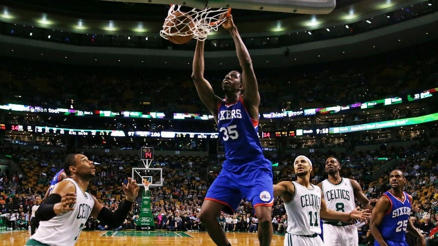 Philadelphia 76ers center Henry Sims (35) dunks against the Boston Celtics during the second half of an NBA basketball game Friday, April 4, 2014, in Boston. The 76ers defeated the Celtics 111-102. (AP Photo/Charles Krupa)