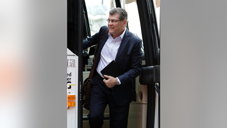 Connecticut coach Geno Auriemma gets off the team bus as he arrives at a hotel Thursday, April 3, 2014, in Nashville, Tenn. Connecticut is scheduled to play Stanford in the semifinals of the NCAA women's college basketball tournament Sunday. (AP Photo/Mark Humphrey)