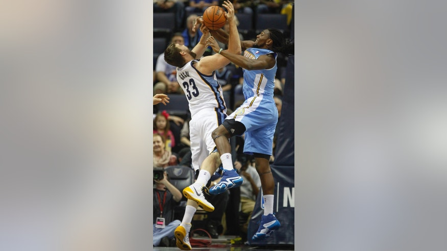 Memphis Grizzlies center Marc Gasol (33) of Spain, gets tangled with Denver Nuggets forward Kenneth Faried in the first half of an NBA basketball game Friday, April 4, 2014, in Memphis, Tenn. (AP Photo/Lance Murphey)