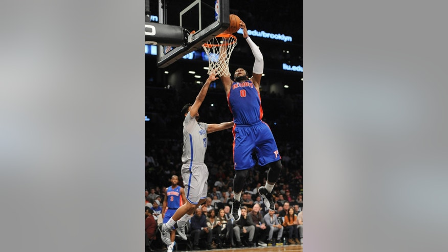 Detroit Pistons' Andre Drummond (0) goes to the basket over Brooklyn Nets' Jorge Gutierrez (13) in the second half of an NBA basketball game on Friday, April 4, 2014, in New York. (AP Photo/Kathy Kmonicek)