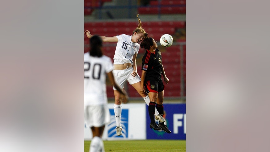 FILE - In this March 9, 2012, file photo, Samantha Mewis of the U.S., left center, and Mexico's Ariana Martinez, right, jump for the ball during a Concacaf women's under 20 semifinal soccer match in Panama City. U.S. Mewis was called up for two international friendly soccer games against China PR, beginning Sunday, April, 6, 2014, in the Mile High City. Mewis will join her older sister, Kristie Mewis. (AP Photo/Arnulfo Franco, File)