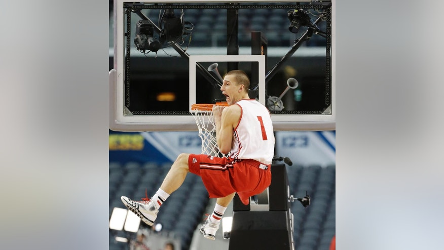 Wisconsin guard Ben Brust dunks the ball during practice for an NCAA Final Four tournament college basketball semifinal game Friday, April 4, 2014, in Dallas. Wisconsin plays Kentucky on Saturday, April 5, 2014. (AP Photo/David J. Phillip)
