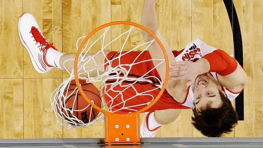 Wisconsin forward Frank Kaminsky makes a basket during practice for an NCAA Final Four tournament college basketball semifinal game Friday, April 4, 2014, in Dallas. Wisconsin plays Kentucky on Saturday, April 5, 2014. (AP Photo/David J. Phillip)