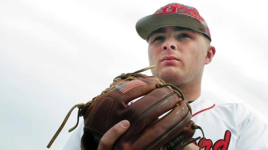 In this photo made Wednesday, April 2, 2014, University of Hartford pitcher Sean Newcomb poses for a photo on the school's baseball field in Hartford, Conn. The 6-foot-5 left hander has not given up an earned run this season and is considered a top major-league prospect. (AP Photo/Pat Eaton-Robb)