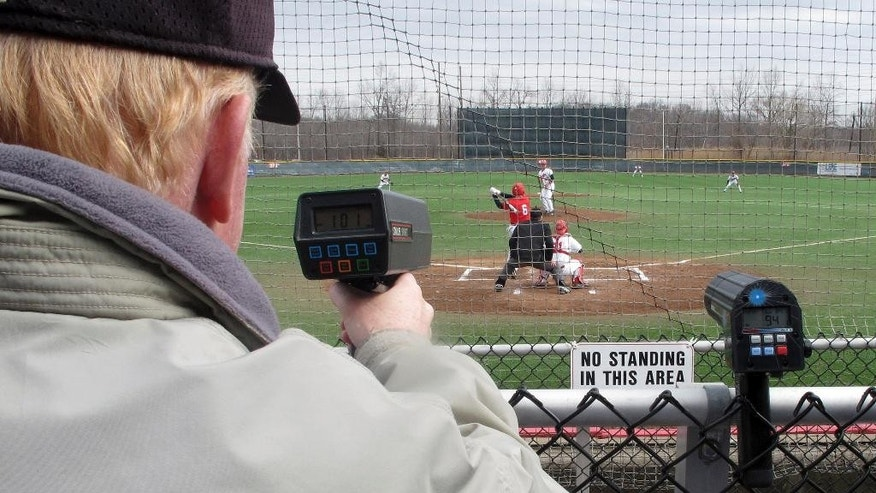 In this photo made Saturday, March 29, 2014, a scout clocks University of Hartford pitcher Sean Newcomb's fastball at more than 100 mph during a baseball game against Stony Brook in Hartford, Conn. Newcomb, a 6-foot-5 left hander, has not given up an earned run this season and is considered a top major-league prospect. (AP Photo/Pat Eaton-Robb)