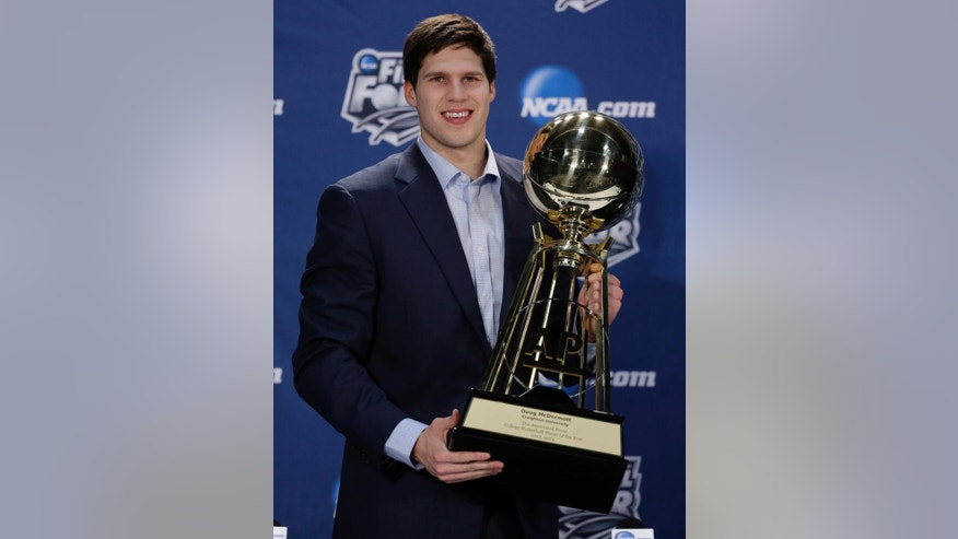 Creighton's Doug McDermott holds up his AP College Basketball Player of the Year trophy at a news conference Thursday, April 3, 2014, in Dallas. (AP Photo/David J. Phillip)