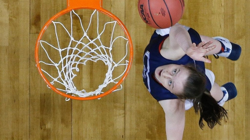 Connecticut guard Tierney Lawlor (20) works during practice before the women's Final Four of the NCAA college basketball tournament, Saturday, April 5, 2014, in Nashville, Tenn. Maryland plays Notre Dame Sunday. (AP Photo/Mark Humphrey)