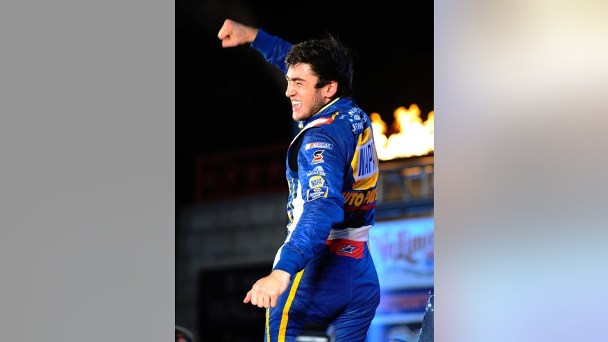 Chase Elliott celebrates in Victory Lane after winning the NASCAR Nationwide Series auto race at Texas Motor Speedway in Fort Worth, Texas, Friday, April 4, 2014. (AP Photo/Ralph Lauer)