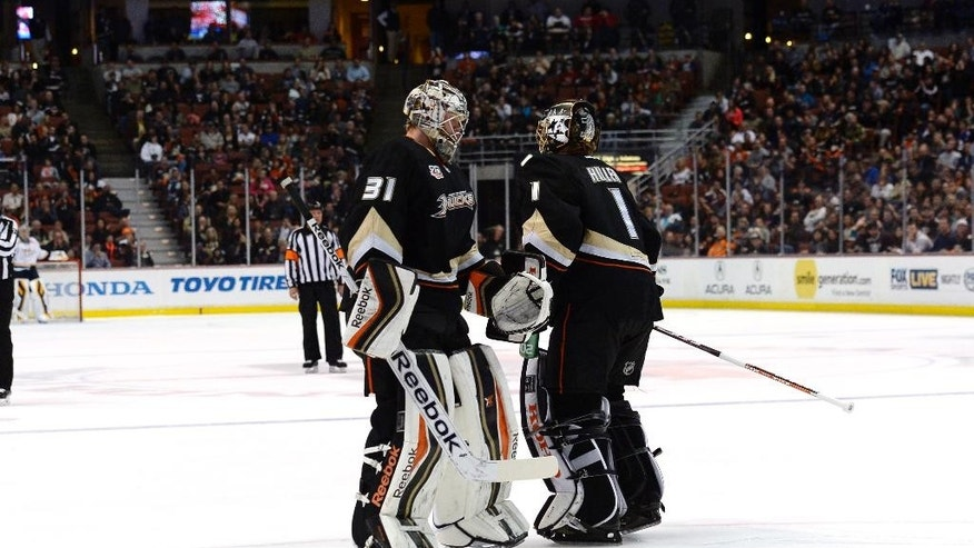 Anaheim Ducks goalie Jonas Hiller (1) is replaced by Ducks goalie Frederik Andersen (31) after giving up four goals to the Nashville Predators during the first period of an NHL hockey game in Anaheim, Calif., Friday, April 4, 2014. (AP Photo/Kevork Djansezian)