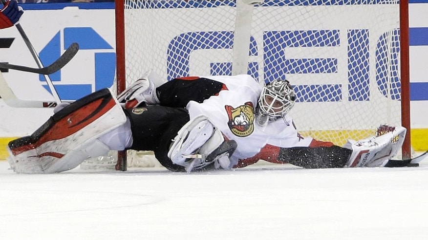 Ottawa Senators goalie Robin Lehner stops a shot during the first period of an NHL hockey game against the New York Rangers on Saturday, April 5, 2014, in New York. (AP Photo/Frank Franklin II)