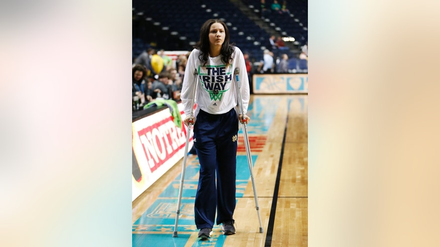 Notre Dame's Natalie Achonwa watches practice  before the women's Final Four of the NCAA college basketball tournament, Saturday, April 5, 2014, in Nashville, Tenn. Notre Dame will play Maryland Sunday. (AP Photo/Mark Humphrey)