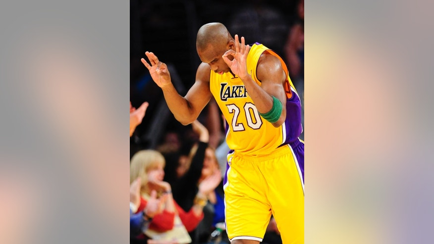 Los Angeles Lakers guard Jodie Meeks celebrate a 3-point shot in the first half of an NBA basketball game against the Dallas Mavericks, Friday, April 4, 2014, in Los Angeles. (AP Photo/Gus Ruelas)