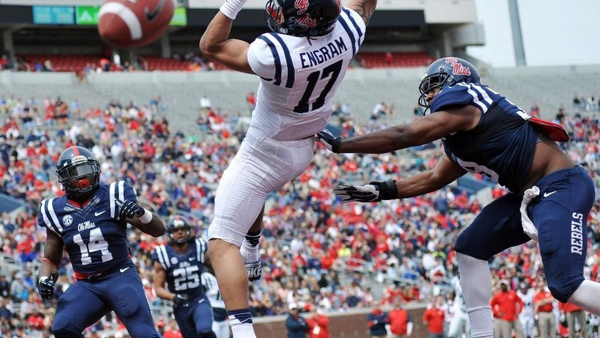 A pass is incomplete to Evan Engram (17) as Deterrian Shackelford (38) moves in during Mississippi's Grove Bowl controlled football scrimmage at Vaught-Hemingway Stadium in Oxford, Miss., Saturday, April 5, 2014. (AP Photo/Oxford Eagle, Bruce Newman) MAGAZINES OUT; NO SALES; MANDATORY CREDIT