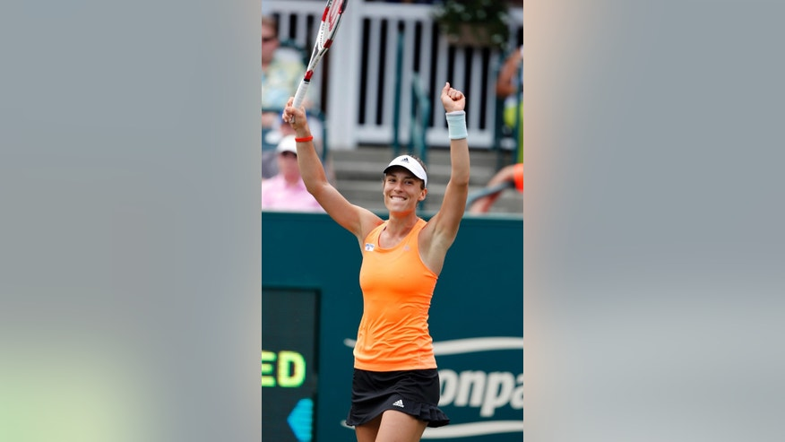 Andrea Petkovic, of Germany, celebrates defeating Eugenie Bouchard, of Canada, in three sets during the Family Circle Cup tennis tournament in Charleston, S.C., Saturday, April 5, 2014. Petkovic won 1-6, 6-3, 7-5, to reach the finals. (AP Photo/Mic Smith)