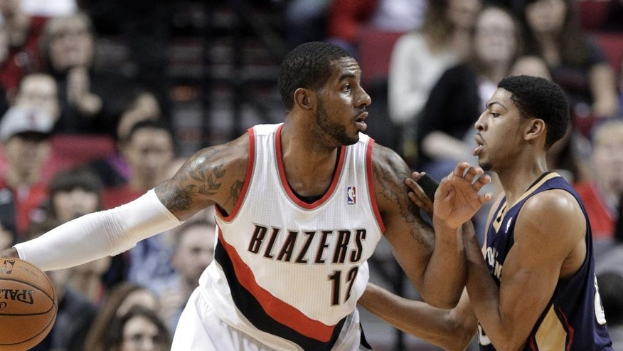 Portland Trail Blazers forward LaMarcus Aldridge, left, looks for an opening against New Orleans Pelicans forward Anthony Davis during the first half of an NBA basketball game in Portland, Ore., Sunday, April 6, 2014. (AP Photo/Don Ryan)
