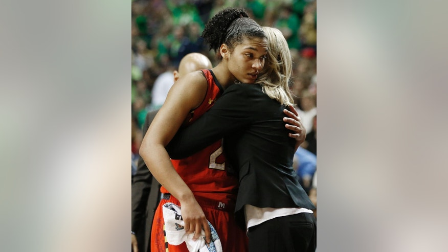 Maryland forward Alyssa Thomas (25) embraces a member of the Maryland team during the second half of the semifinal game against Notre Dame in the Final Four of the NCAA women's college basketball tournament, Sunday, April 6, 2014, in Nashville, Tenn. Notre Dame won 87-61. (AP Photo/John Bazemore)