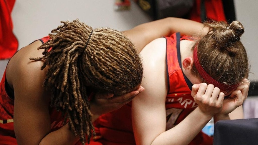 Maryland center Malina Howard, left and Sequoia Austin embrace after the semifinal game against Notre Dame in the Final Four of the NCAA women's college basketball tournament, Sunday, April 6, 2014, in Nashville, Tenn. Notre Dame won 87-61. (AP Photo/Mark Humphrey)