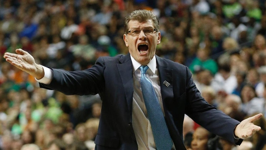 Connecticut head coach Geno Auriemma speaks to an official during the first half of the semifinal game against Stanford in the Final Four of the NCAA women's college basketball tournament, Sunday, April 6, 2014, in Nashville, Tenn. (AP Photo/John Bazemore)