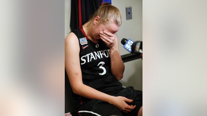 Stanford forward Mikaela Ruef sits in the locker room after the second half of the semifinal game against Connecticut in the Final Four of the NCAA women's college basketball tournament, Sunday, April 6, 2014, in Nashville, Tenn. Connecticut won 75-56. (AP Photo/John Bazemore)