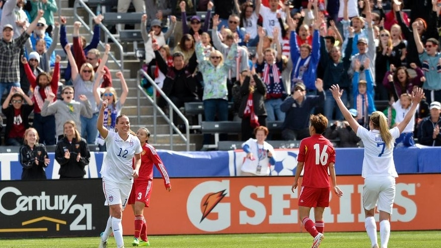 U.S. midfielder Lauren Holiday (12) celebrates her goal against China during the first half of an international friendly soccer match in Commerce City, Colo., on Sunday, April 6, 2014. (AP Photo/Jack Dempsey)