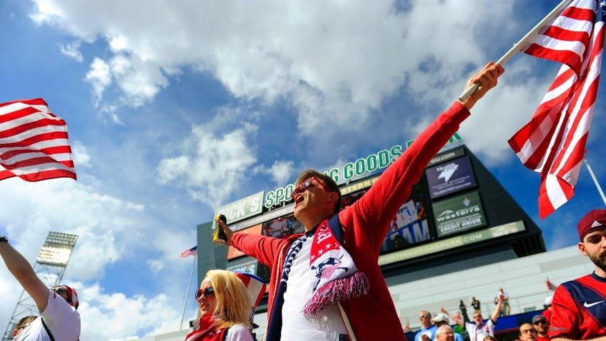 U.S.soccer fans cheers during the first half of the team's international friendly soccer match against China in Commerce City, Colo., on Sunday, April 6, 2014. (AP Photo/Jack Dempsey)