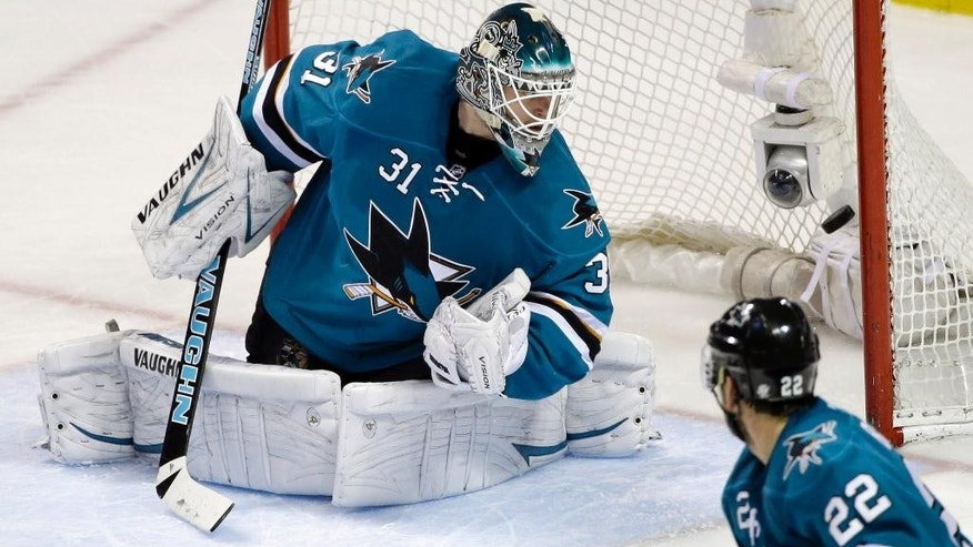 San Jose Sharks goalie Antti Niemi, of Finland, is beaten for a goal on a shot from Nashville Predators right wing Patric Hornqvist during the second period of an NHL hockey game Saturday, April 5, 2014, in San Jose, Calif. (AP Photo/Marcio Jose Sanchez)