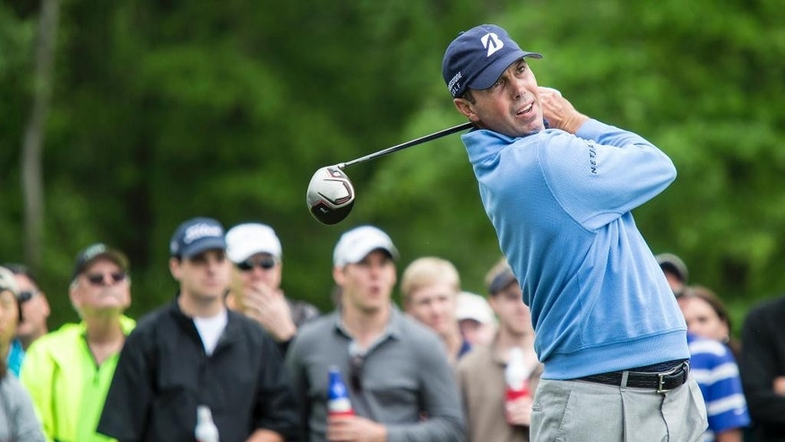 Matt Kuchar tees off on the 11th hole during the third round of the Houston Open golf tournament on Saturday, April 5, 2014, in Humble, Texas. (AP Photo/The Courier, Andrew Buckley)