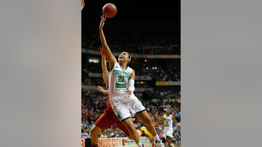 Notre Dame guard Kayla McBride (21) shoots against Maryland during the second half of the championship game in the Final Four of the NCAA women's college basketball tournament, Sunday, April 6, 2014, in Nashville, Tenn. (AP Photo/John Bazemore)