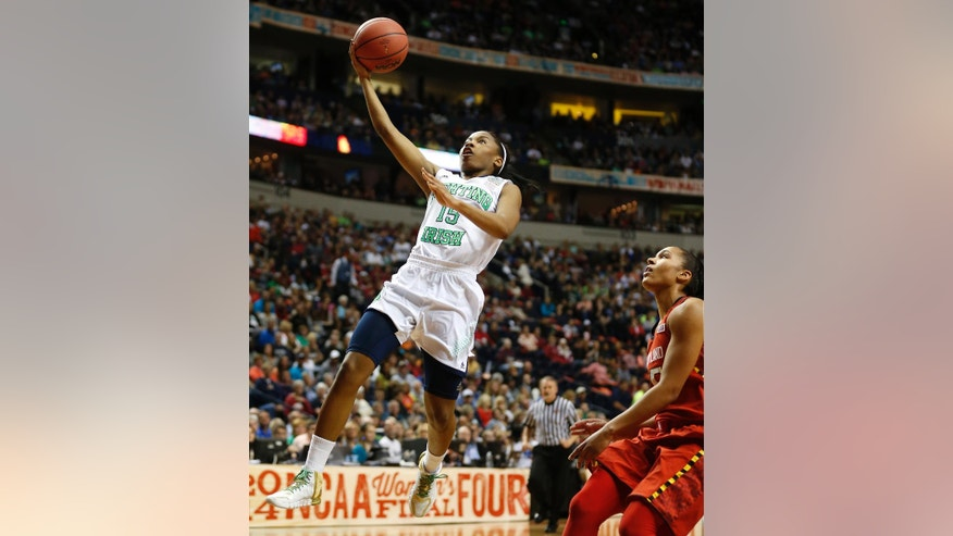 Notre Dame guard Lindsay Allen (15) shoots past Maryland forward Alyssa Thomas (25) during the first half of the championship game in the Final Four of the NCAA women's college basketball tournament, Sunday, April 6, 2014, in Nashville, Tenn. (AP Photo/John Bazemore)