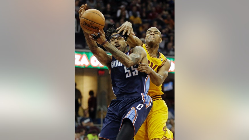 Cleveland Cavaliers' Jarrett Jack, right, fouls Charlotte Bobcats' Chris Douglas-Roberts (55) on a drive to the basket in the fourth quarter of an NBA basketball game on Saturday, April 5, 2014, in Cleveland. The Bobcats won 96-94 in overtime. (AP Photo/Mark Duncan)