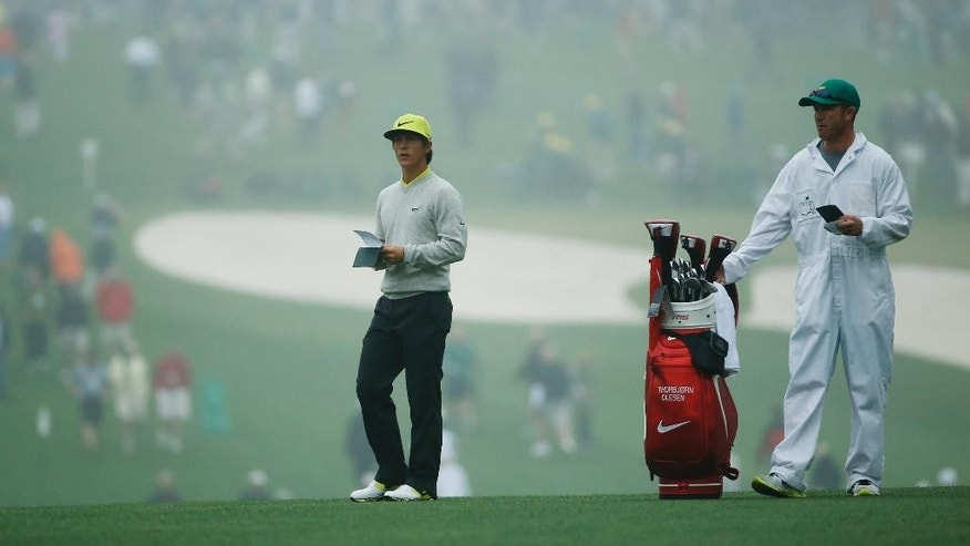 Thorbjorn Olesen, of Denmark, takes notes before hitting on first fairway during a practice session for the Masters golf tournament Monday, April 7, 2014, in Augusta, Ga.the Masters golf tournament Monday, April 7, 2014, in Augusta, Ga. (AP Photo/Matt Slocum)