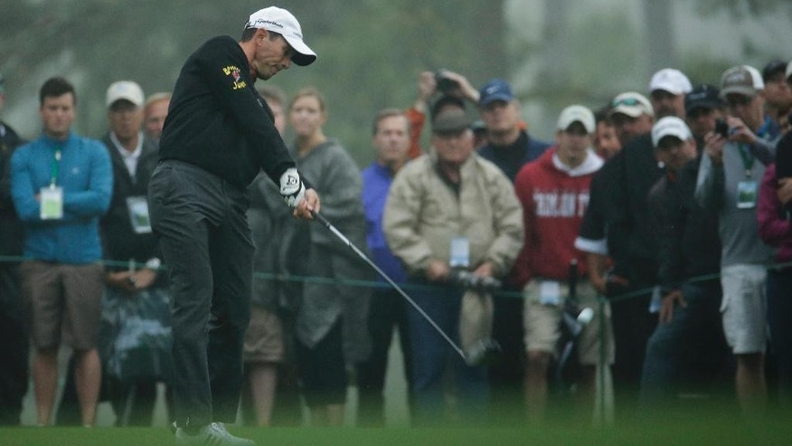 Mike Weir, of Canada, tees off on the 18th hole during a practice round for the Masters golf tournament Monday, April 7, 2014, in Augusta, Ga. (AP Photo/Charlie Riedel)