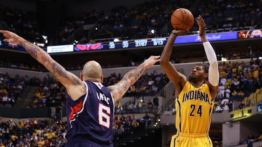 Indiana Pacers forward Paul George (24) shoots the basketball defended by Atlanta Hawks center Pero Antic in the second half of an NBA basketball game in Indianapolis, Sunday, April 6, 2014. Atlanta won 107-88.  (AP Photo/R Brent Smith)