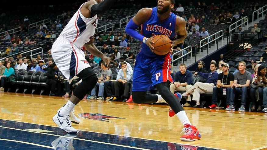 Detroit Pistons forward Greg Monroe (10) drives to the basket against Atlanta Hawks forward Paul Millsap (4) in the first period in an NBA basketball game in Atlanta, Tuesday, April 8, 2014. (AP Photo/Todd Kirkland)