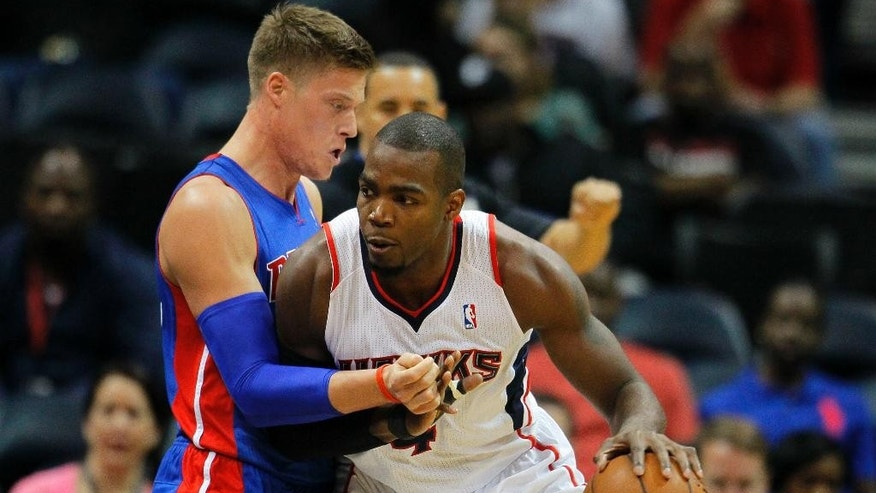 Atlanta Hawks forward Paul Millsap (4) drives to the basket against Detroit Pistons forward Jonas Jerebko (33) in the first period of an NBA basketball game against the Atlanta Hawks in Atlanta, Tuesday, April 8, 2014. (AP Photo/Todd Kirkland)