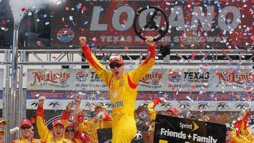 Joey Logano celebrates winning the NASCAR Sprint Cup Series auto race at Texas Motor Speedway Monday, April 7, 2014, in Fort Worth, Texas. (AP Photo/Mike Stone)