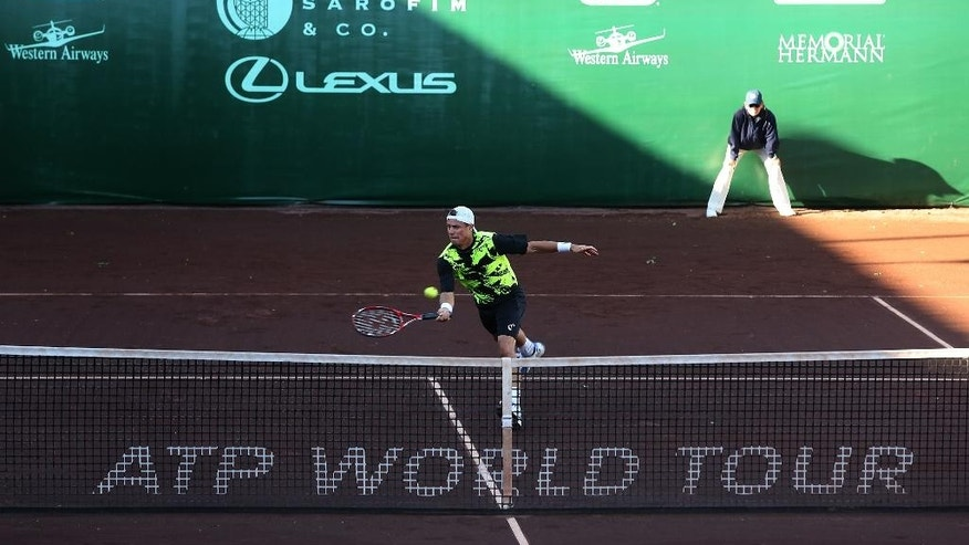 Lleyton Hewitt, of Australia, returns a shot to Peter Polansky, of Canada, at the U.S. Men's Clay Court Championship tennis tournament, Tuesday, April 8, 2014, in Houston. Hewitt won 6-4, 3-6, 6-4. (AP Photo/Houston Chronicle, Thomas B. Shea) MANDATORY CREDIT