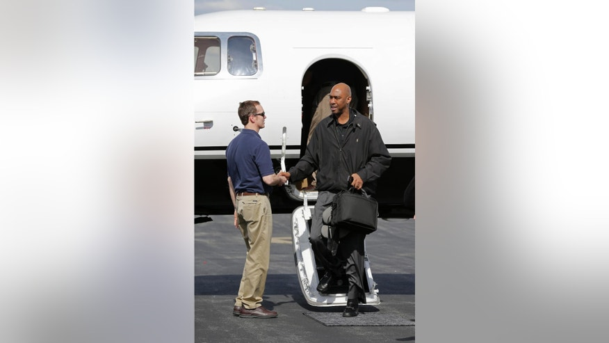 Newly hired Wake Forest head basketball coach Danny Manning, right, is greeted as he arrives at Smith-Reynolds Airport in Winston-Salem, N.C., Tuesday, April 8, 2014. (AP Photo/Chuck Burton)