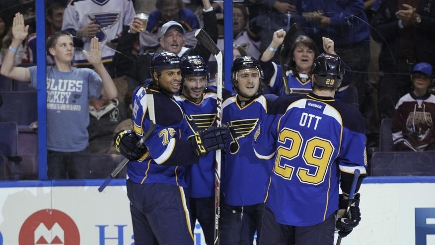 St. Louis Blues' Maxim Lapierre, second from left, celebrates with teammates after scoring a goal during the second period of an NHL hockey game against the Washington Capitals, Tuesday, April 8, 2014, in St. Louis.(AP Photo/Tom Gannam)
