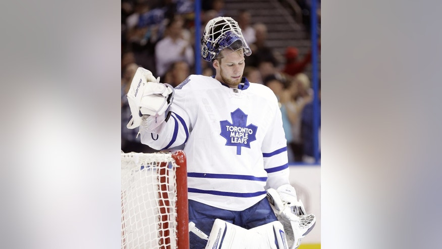 Toronto Maple Leafs goalie James Reimer (34) reacts after giving up a goal to Tampa Bay Lightning left wing Ondrej Palat, of the Czech Republic, during the second period of an NHL hockey game Tuesday, April 8, 2014, in Tampa, Fla. (AP Photo/Chris O'Meara)