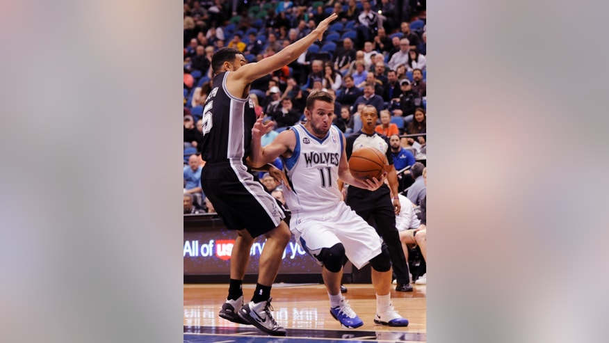 Minnesota Timberwolves' J.J. Barea (11) drives against San Antonio Spurs' Cory Joseph (5) in an NBA basketball game at the Target Center on in Minneapolis on Tuesday, April 8, 2014. Timberwolves won 110-91. (AP Photo/Hannah Foslien)