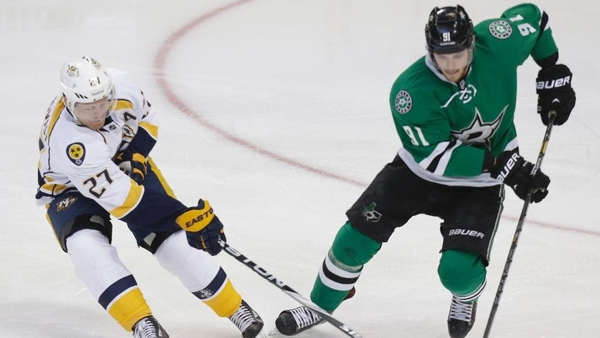 Nashville Predators right wing Patric Hornqvist (27) of Sweden and Dallas Stars center Tyler Seguin (91) skate for the puck  during the first period of an NHL hockey game Tuesday, April 8, 2014, in Dallas. (AP Photo/LM Otero)