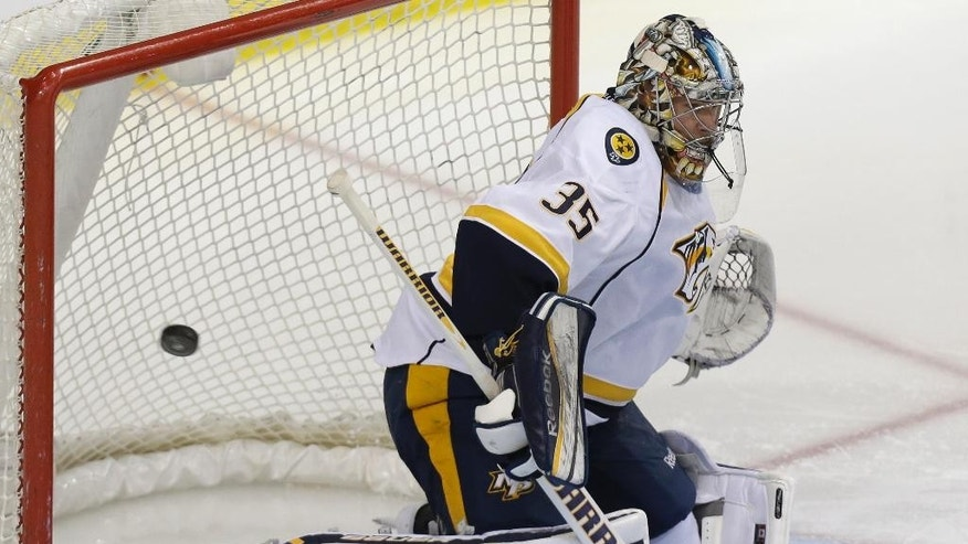 Nashville Predators goalie Pekka Rinne (35) of Finland defends the goal during the first period of an NHL hockey game Tuesday, April 8, 2014, in Dallas. (AP Photo/LM Otero)