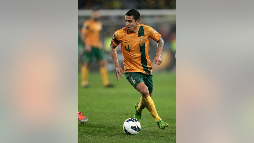 FILE - In this June 18, 2013, file photo, Australia's Tim Cahill carries the ball up against Iraq during their World Cup soccer Asian qualifying match at the Sydney Olympic Stadium in Sydney, Australia. Australia won the match 1-0 and qualify for the 2014 World Cup in Brazil. Australia won one of its group games in South Africa four years ago, but will find it difficult to repeat that feat with an inexperienced squad that is being groomed for the 2018 World Cup in Russia. (AP Photo/Rick Rycroft,File)