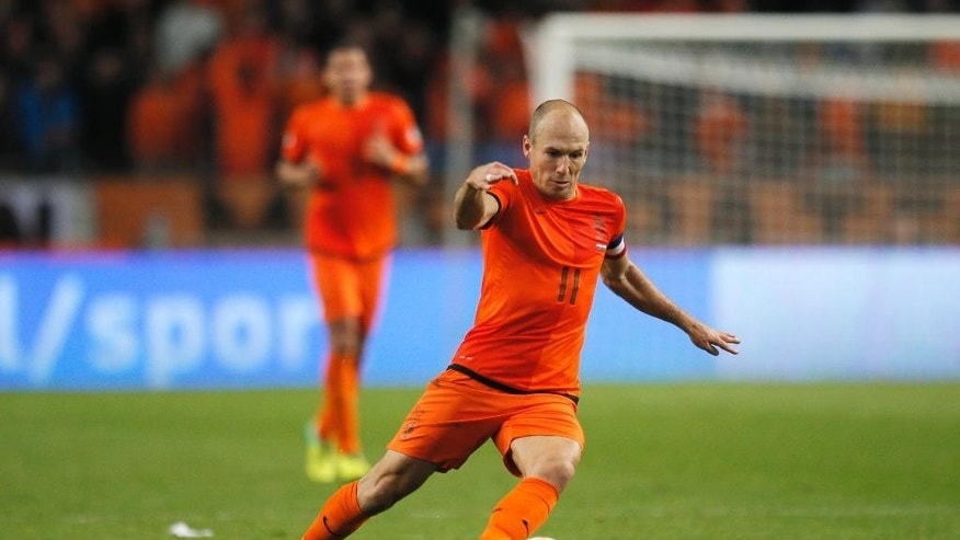 FILE - In this Oct. 11, 2013, file photo, In this Netherlands' Arjen Robben plays the ball during the Group D World Cup qualifying soccer match between Netherlands and Hungary, in Amsterdam, Netherlands. Robin van Persie and Arjen Robben continue to spark the Oranje, but Van Persie must seize the opportunity after the Manchester United striker has scored only once at the last two major tournaments, the 2010 World Cup and Euro 2012. (AP Photo/Peter Dejong, File)