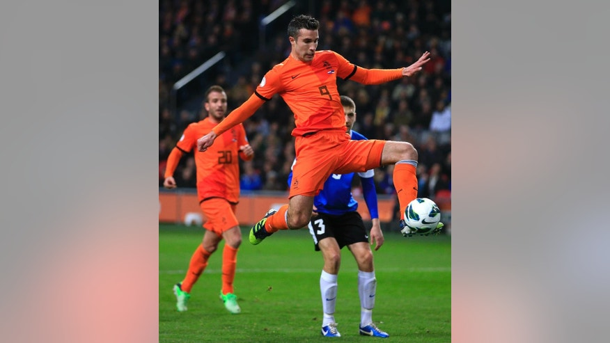 FILE - In this March 22, 2013, file photo, Robin van Persie of The Netherlands scores 2-0 during the Group D world cup qualifying soccer match Netherlands against Estonia in Amsterdam, Netherlands. Robin van Persie and Arjen Robben continue to spark the Oranje, but Van Persie must seize the opportunity after the Manchester United striker has scored only once at the last two major tournaments, the 2010 World Cup and Euro 2012.  (AP Photo/Peter Dejong, File)