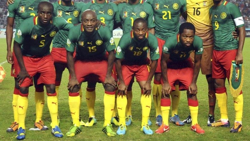 FILE - In this Oct. 13, 2013 file photo, Cameroon soccer team poses prior to the start the World Cup qualifying soccer between Tunisia and Cameroon in Tunis, Tunisia. Foreground from left: Tchounko Nounke, Kouamo Webo, Takang Enouh Eyong and Jean Makoun. Background from left: Allan Romeo Nyom, Bilong Song, Ndoubena Nkoulou, Fongang Chedjou, Job Mtip Joel and Samuel Etoo.  (AP Photo/Salah Habibi, File)