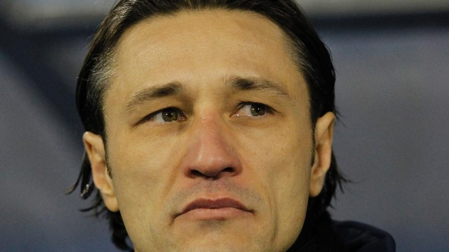 FILE - In this Nov. 19, 2013, file photo, Croatia's head coach Niko Kovac looks on at the beginning of a World Cup qualifying playoff second leg soccer match against Iceland in Zagreb, Croatia. Kovak already knows it wonít be at full strength for the difficult opener against Brazil. (AP Photo/Darko Bandic,File)