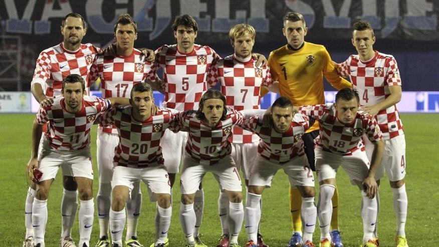 FILE - In this Nov. 19, 2013 file photo, Croatia soccer team poses prior to the start the World Cup qualifying soccer match between Croatia and Iceland in Zagreb, Croatia. Background from left: Josip Simunic, Mario Mandzukic, Vedran Corluka, Ivan Rakitic, Stipe Pletikosa and Ivan Perisic. Foreground from left: Darijo Srna, Mateo Kovacic, Luka Modric, Danijel Pranjic and Ivica Olic.  (AP Photo/Darko Bandic, File)